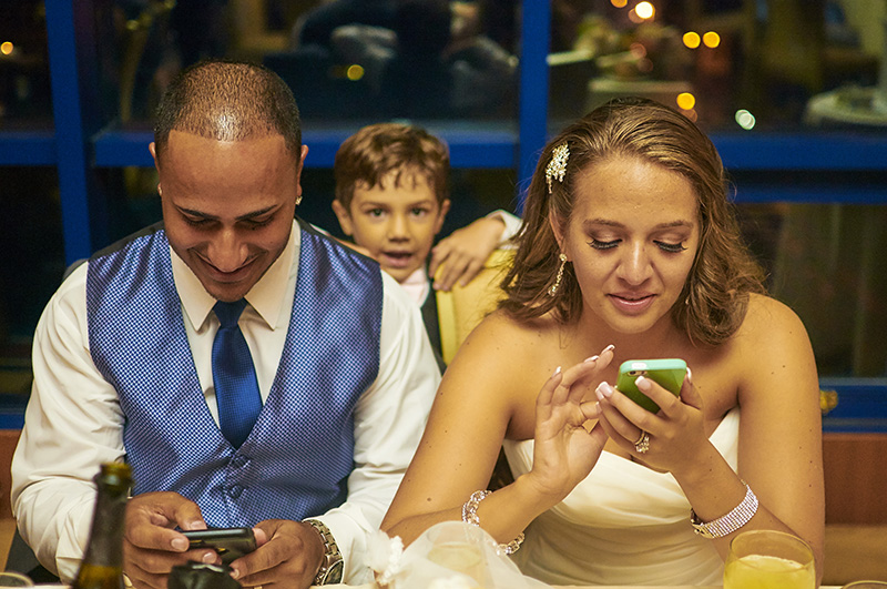 bride and groom texting