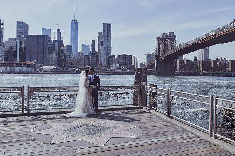 bride and groom under the Brooklyn bridge