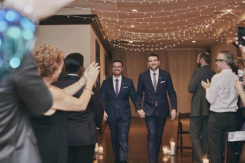 grooms walk down the isle