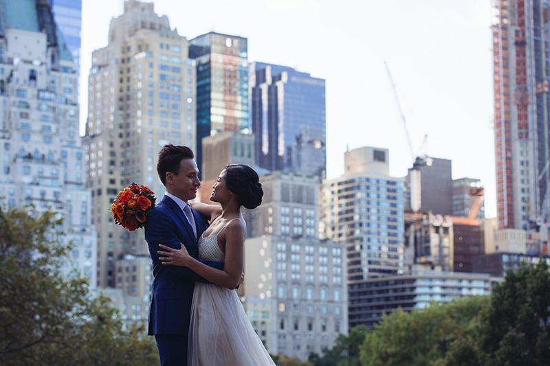wedding couple hugging on Central park rocks