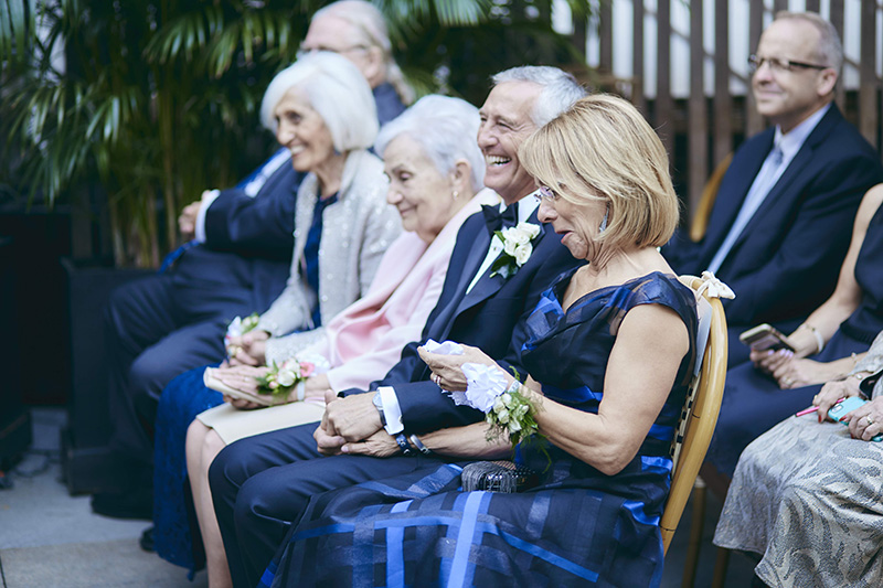 parents of the bride laughing