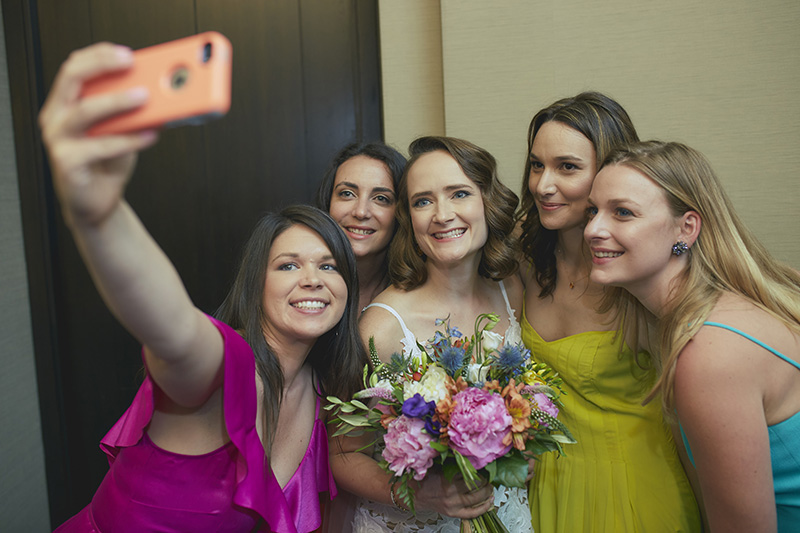 bridesmaids taking selfie