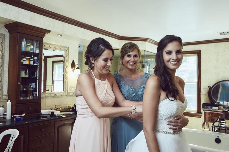 bride maids helping bride