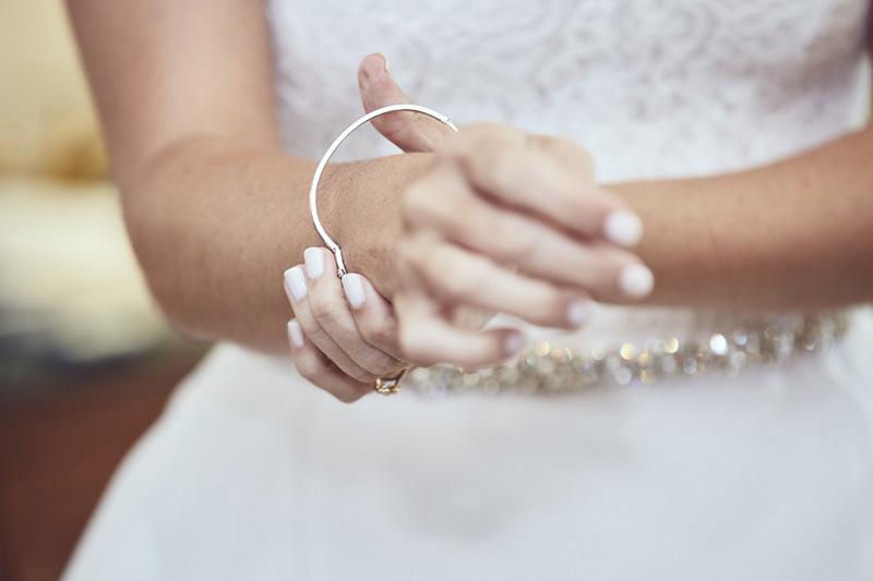 bride's put on the bracelet