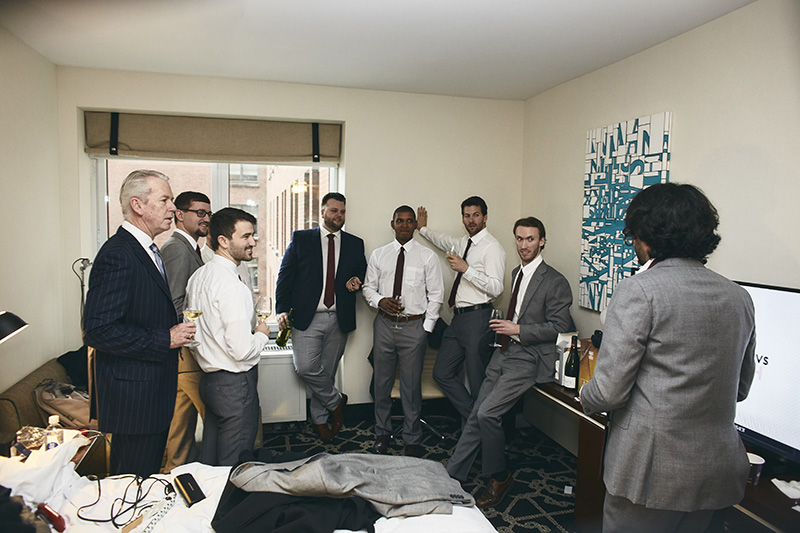 groom with groomsmen getting ready for the wedding