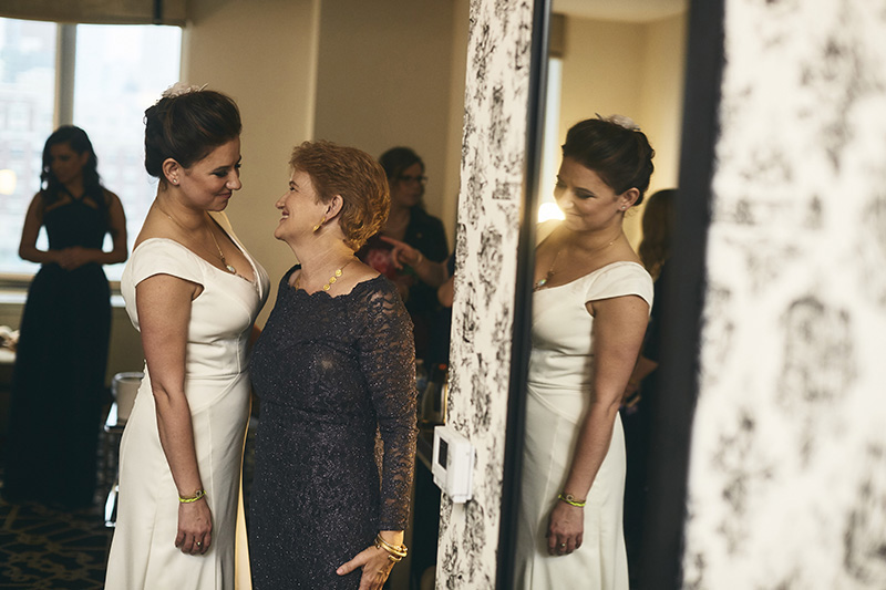 bride with her mother getting ready  for the wedding