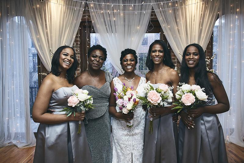Bride posing with braidmaids
