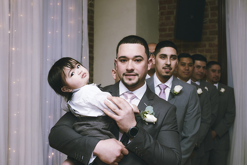 Groom with the baby photography