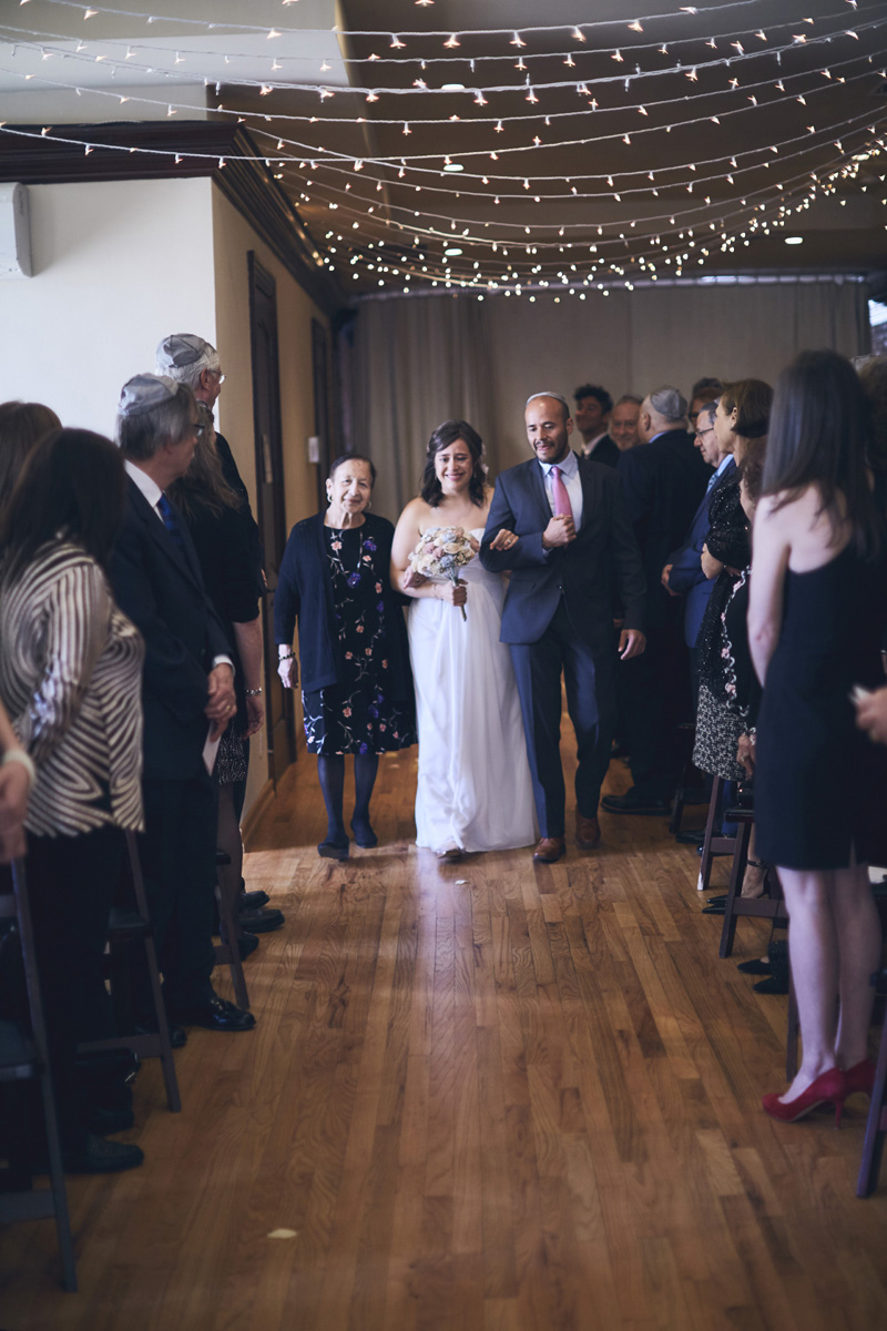 jewish bride walking down the aisle