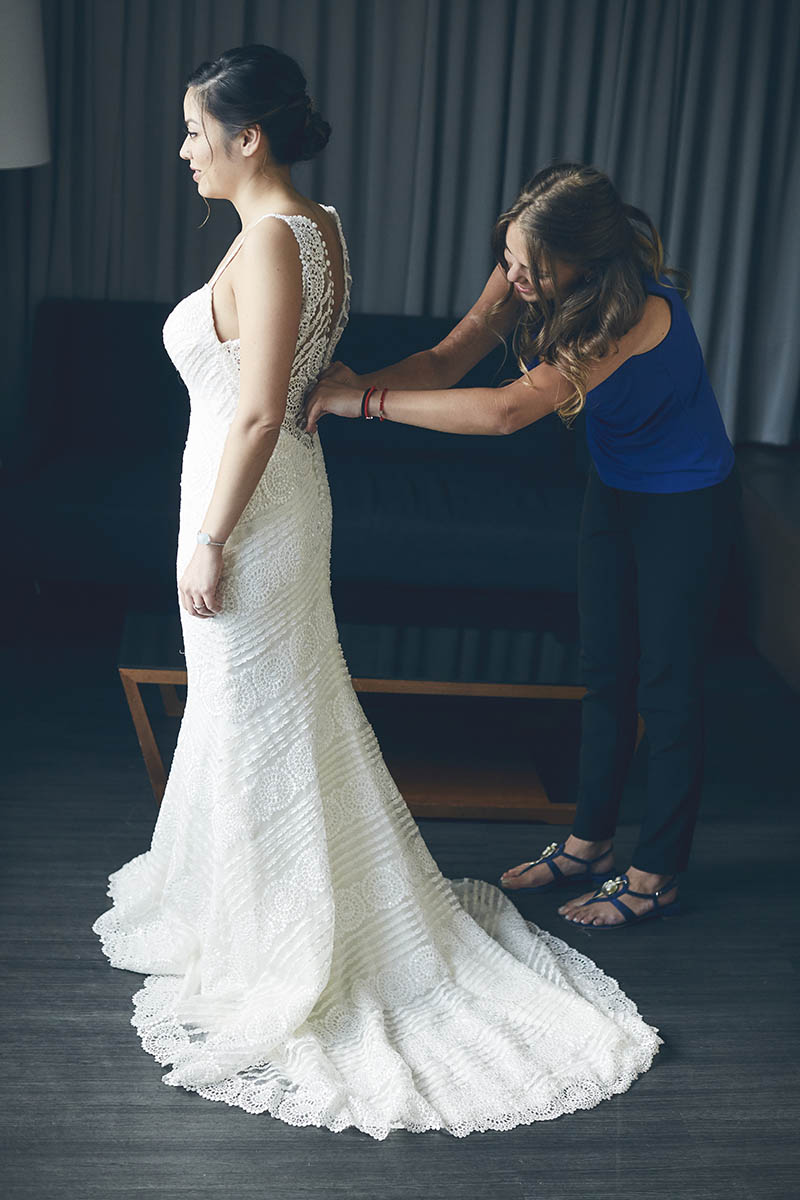 bride putting the dress on
