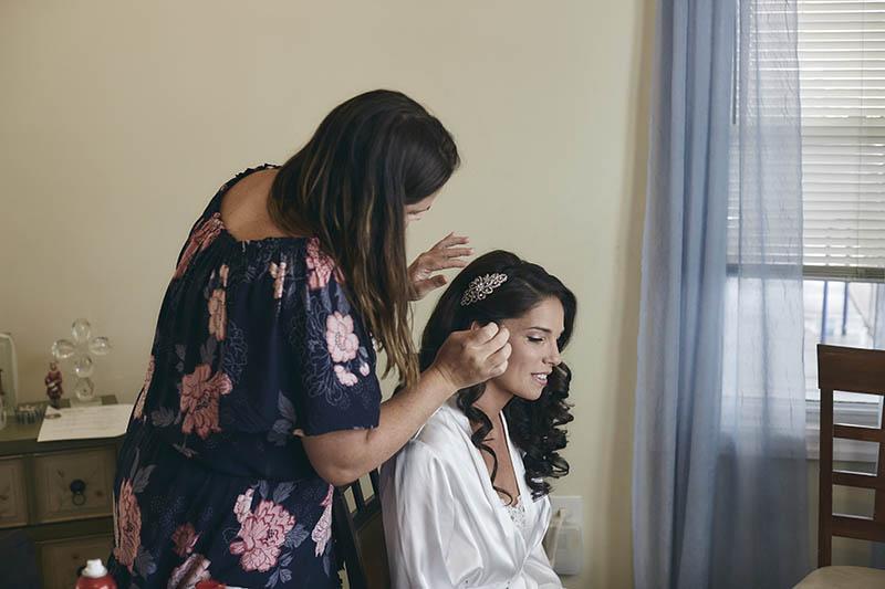 bride fixing her hair