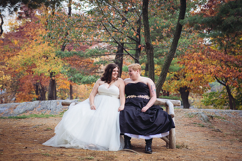 brides sitting on bench