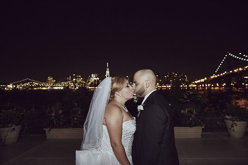 bride and groom kissing at night