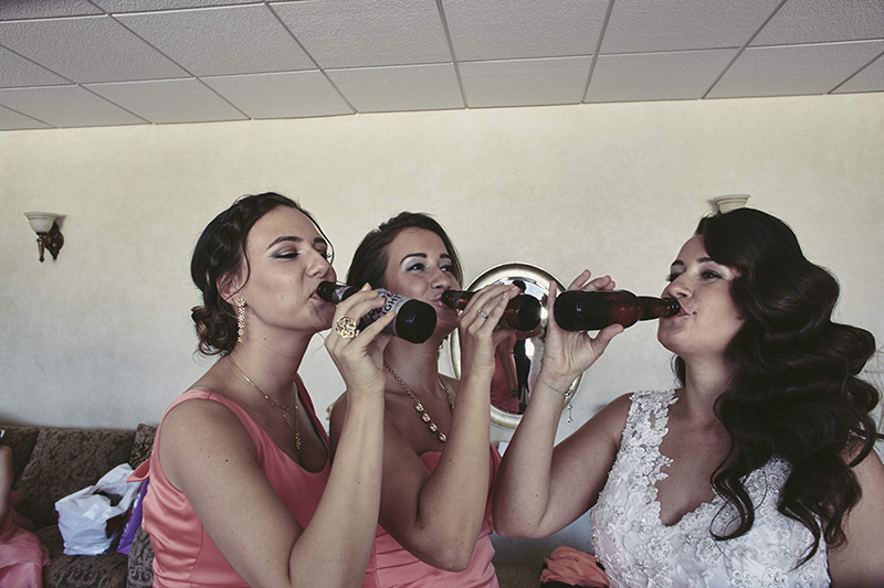 bridesmaids drinking beer