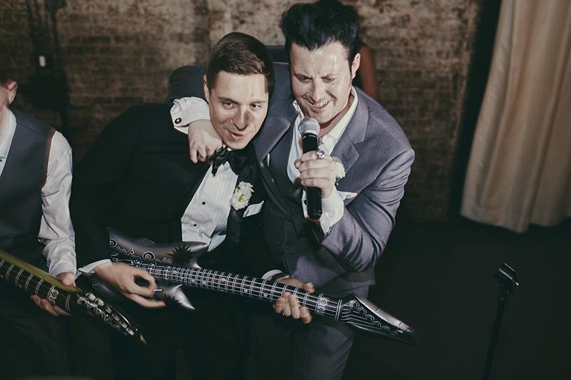 groom and best man singing