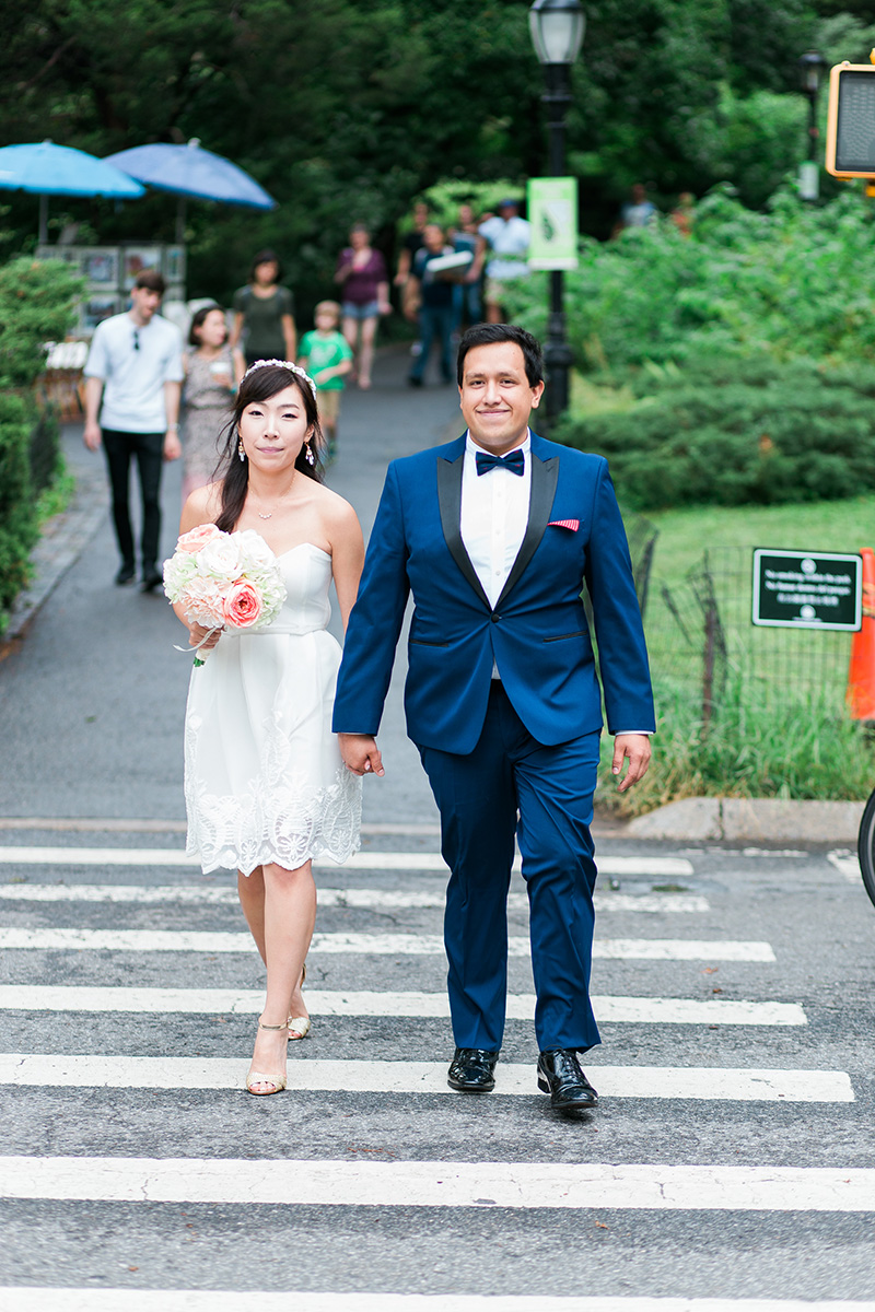 bride and groom walking in central park