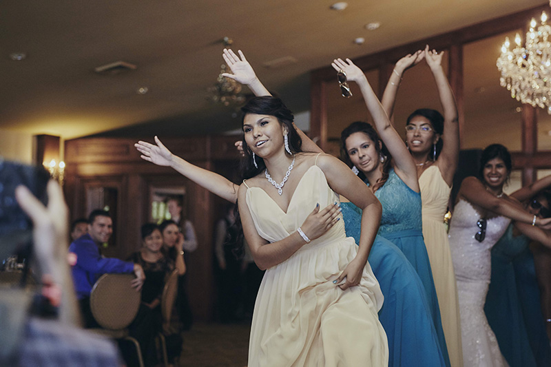 bride and bridesmaids perform
