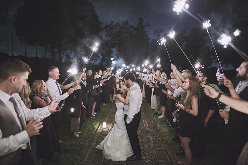 bride and groom under sparklers