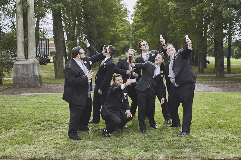 groomsman taking selfies