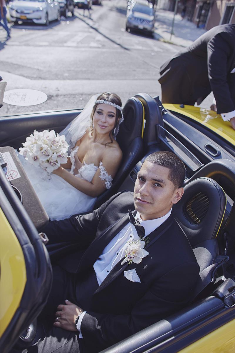 bride and groom in cabriolet