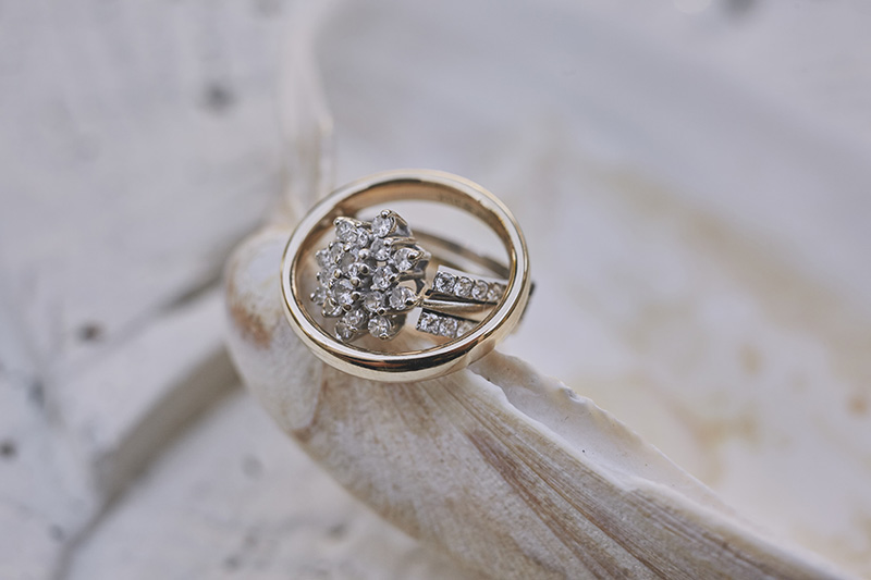 wedding rings on a shell