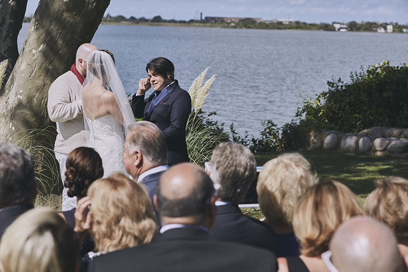 bride crying at wedding ceremony