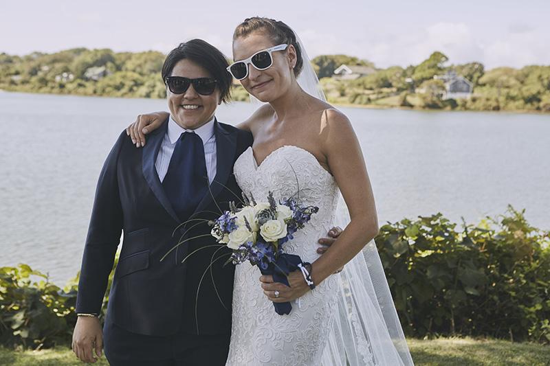 same sex brides with sunglasses