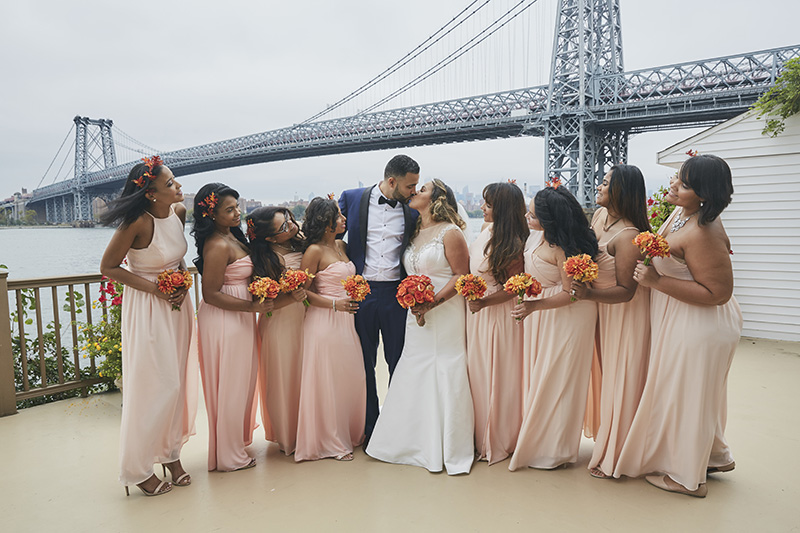 bridesmaids with couple