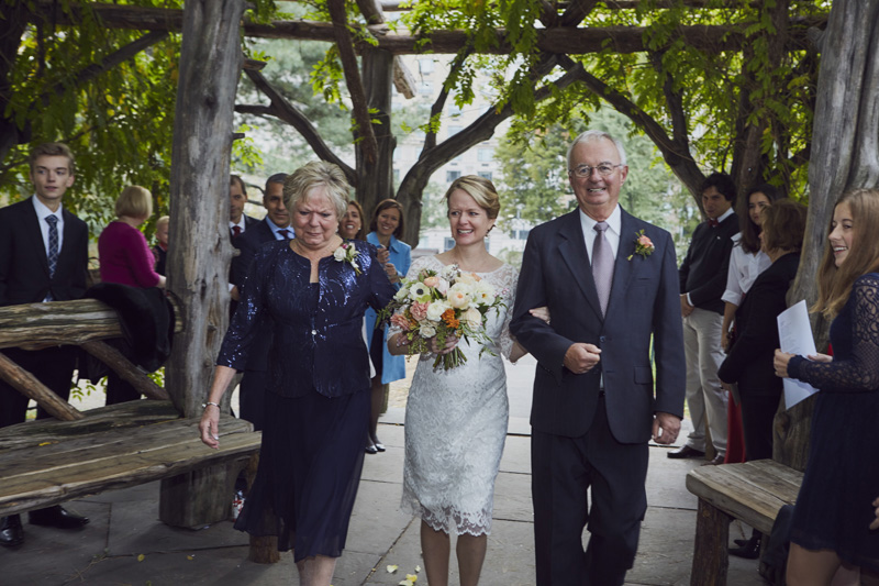 bride walk down the isle with parents
