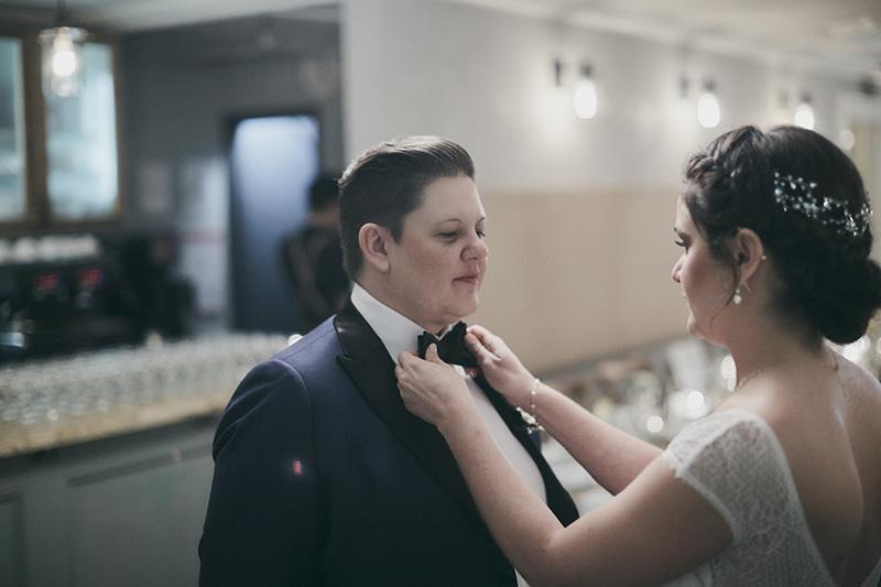 bride helping the groom