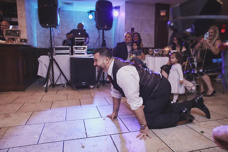 groom on his knees