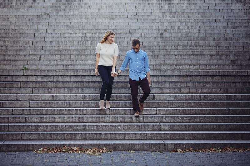 young couple walking down the steps