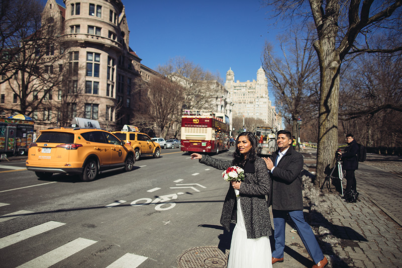 wedding couple calling a cab