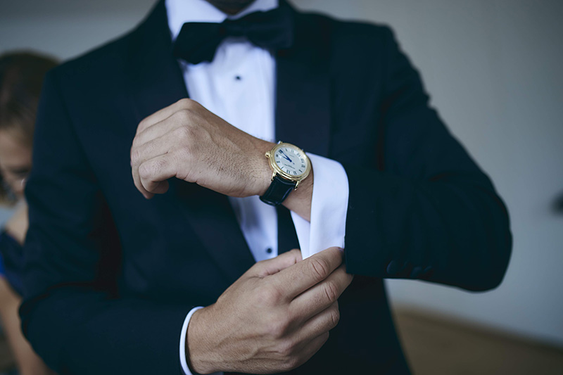 groom putting the watch on wrist