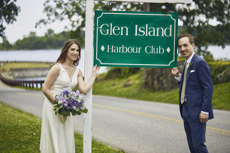 bride and groom with a sign