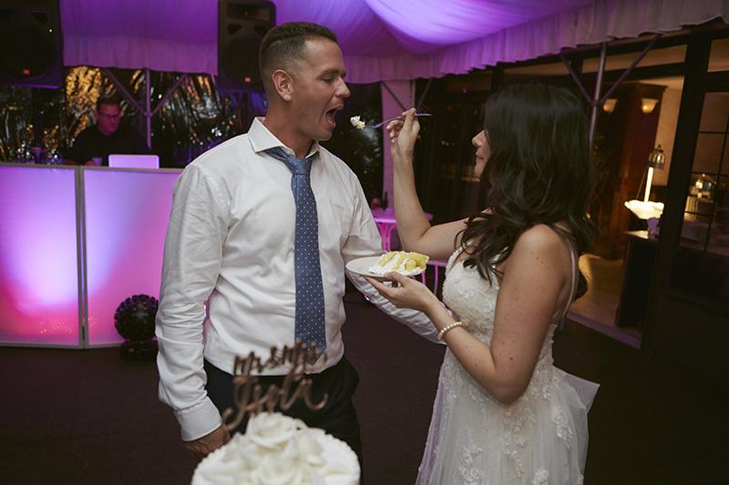 wedding couple feeding each other