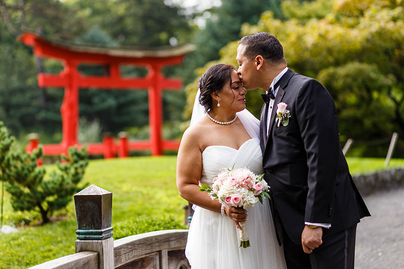 groom kissing bride on forehand