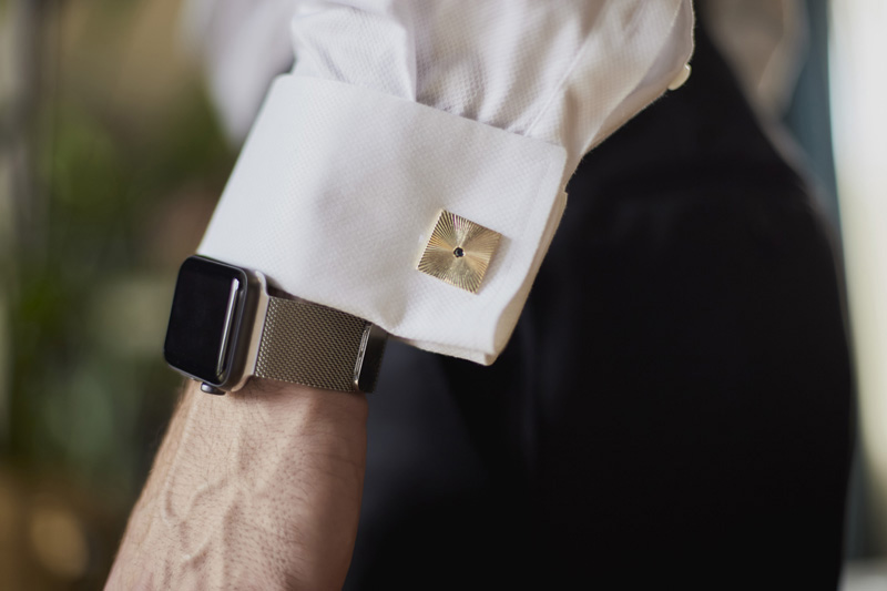 The groom is getting ready, cufflink, hand with cufflink detail