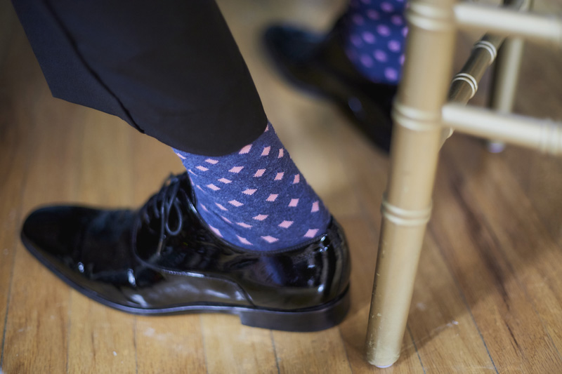 The groom is getting ready, male socks, groom's shoes