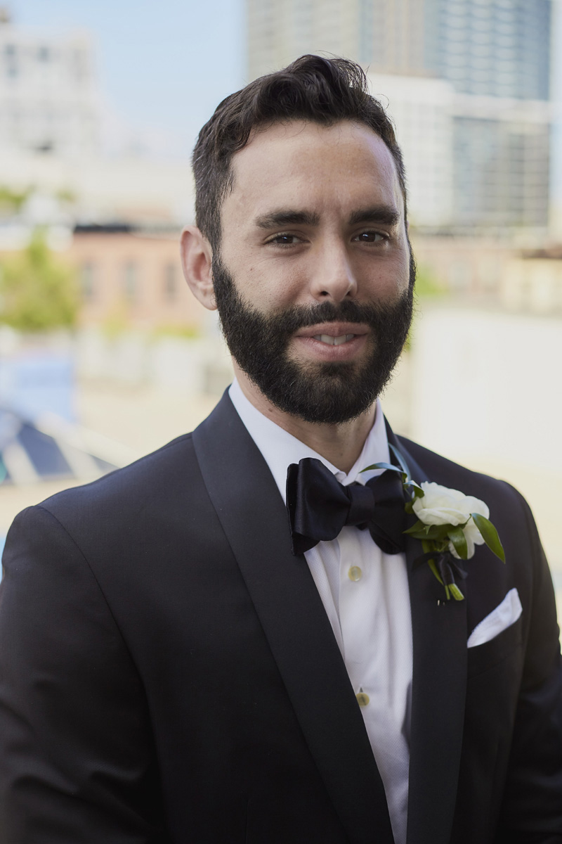 groom on a rooftop, NY, wedding photography