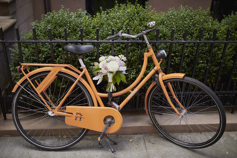 orange bicycle, bridal bouquet