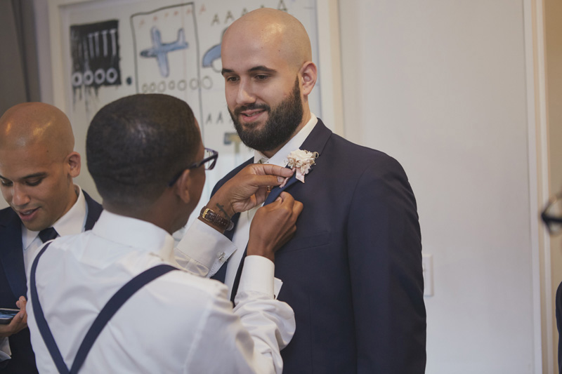 putting on the boutonniere