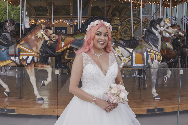 bride in front of the carousel
