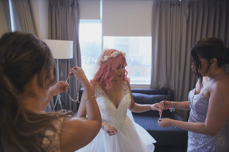Bride put on  shiny jewelry