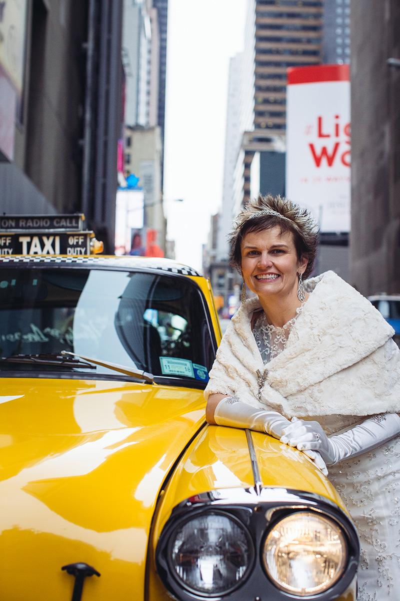 bride with vintage taxi