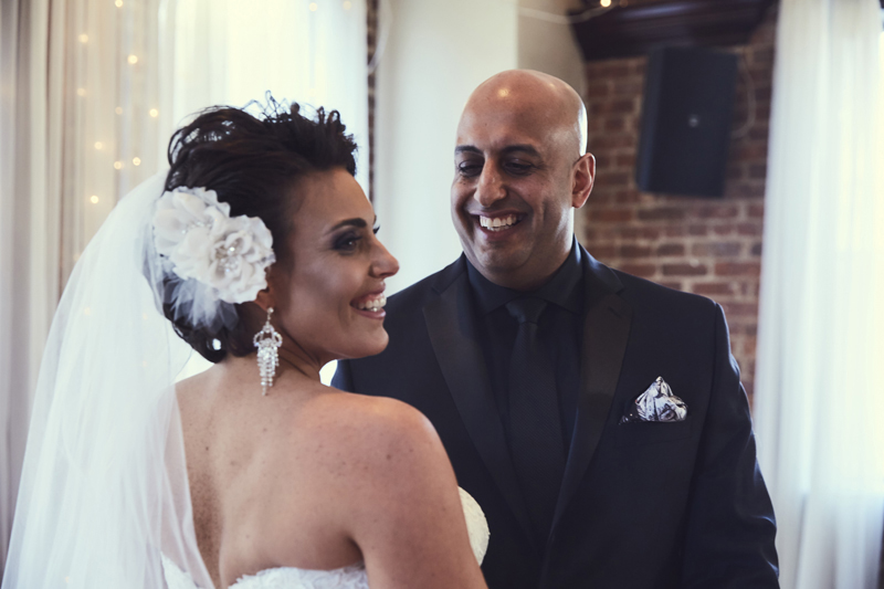 Groom and bride smiling