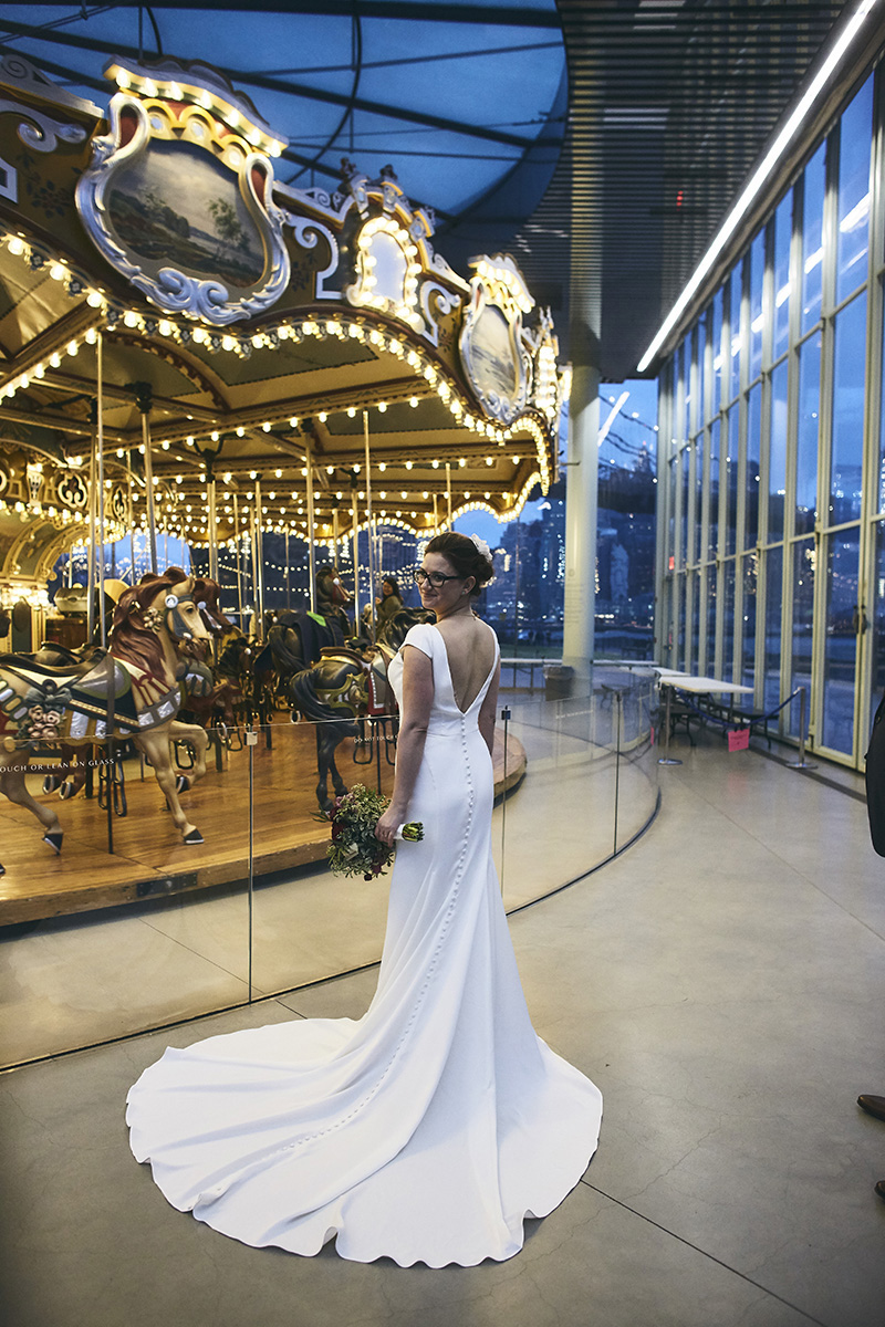 Bride posing by the carousel