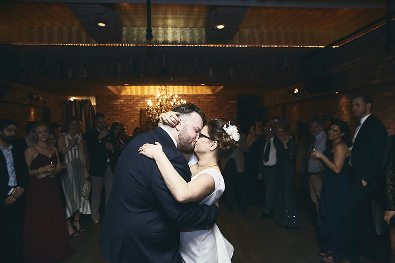 Bride and groom kissing during their wedding dance