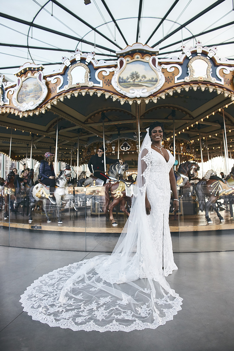 Bride posing in front of carousel