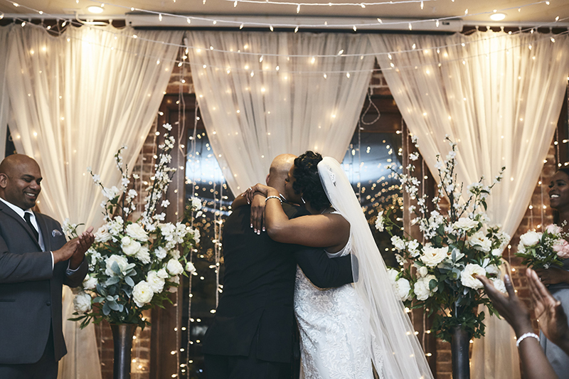 Bride and groom kissing at the end of the wedding ceremony